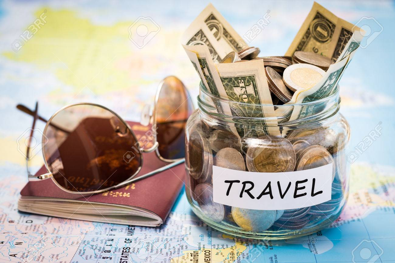 Travel budget concept travel money savings in a glass jar with travel money savings in a glass jar with passport and sunglasses on world map gumiabroncs Choice Image