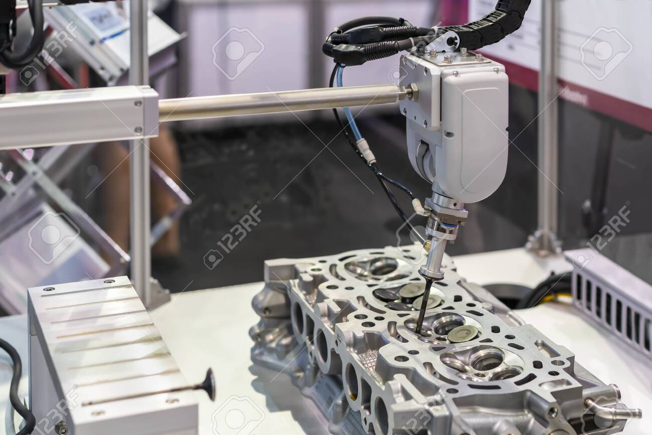 close up suction head and valve shaft during catch remove or assembly in cylinder block engine of vehicle or automobile by automation pneumatic system control - 152948166