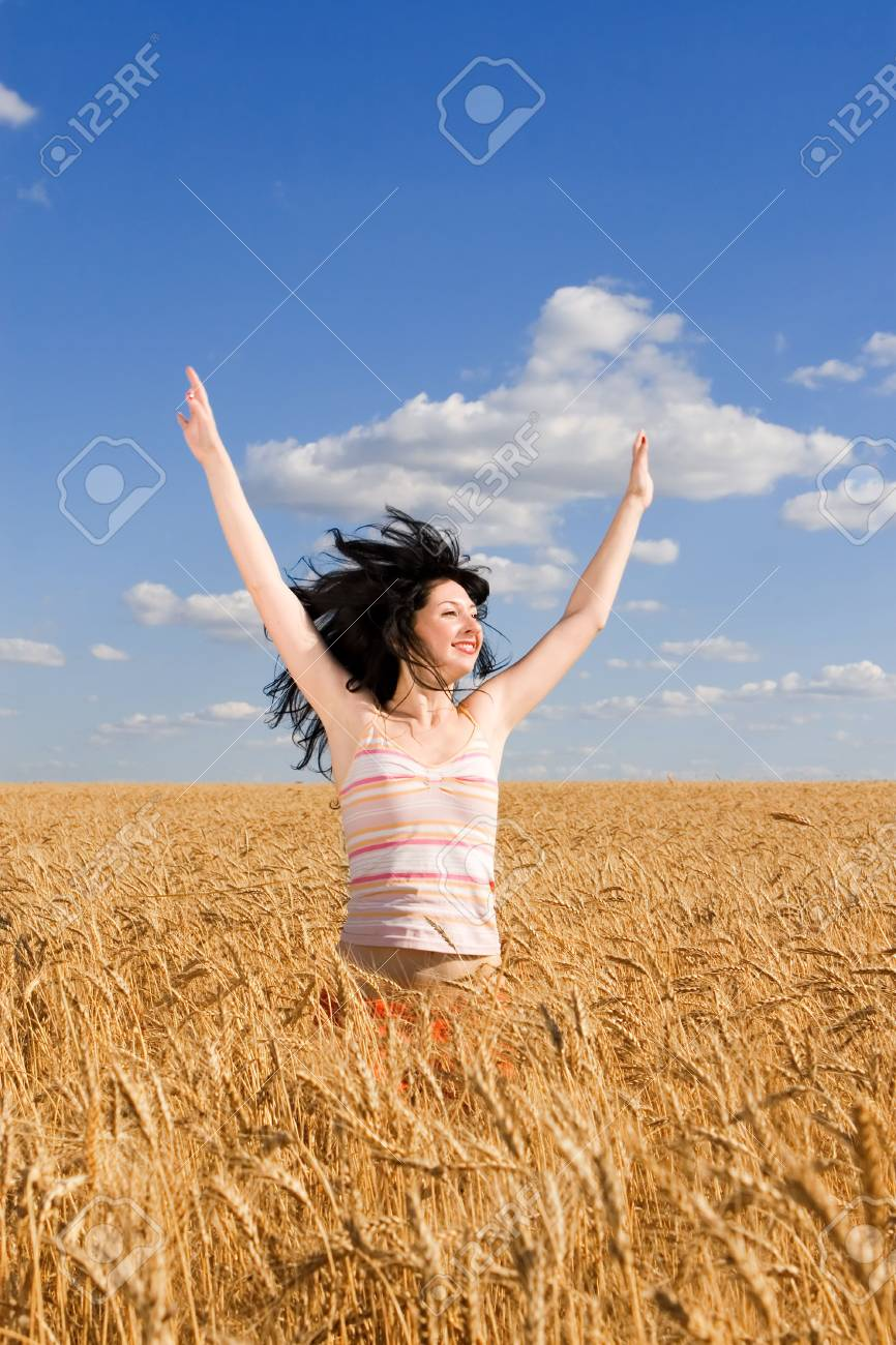 Happy woman jumping in golden wheat Stock Photo - 5015512