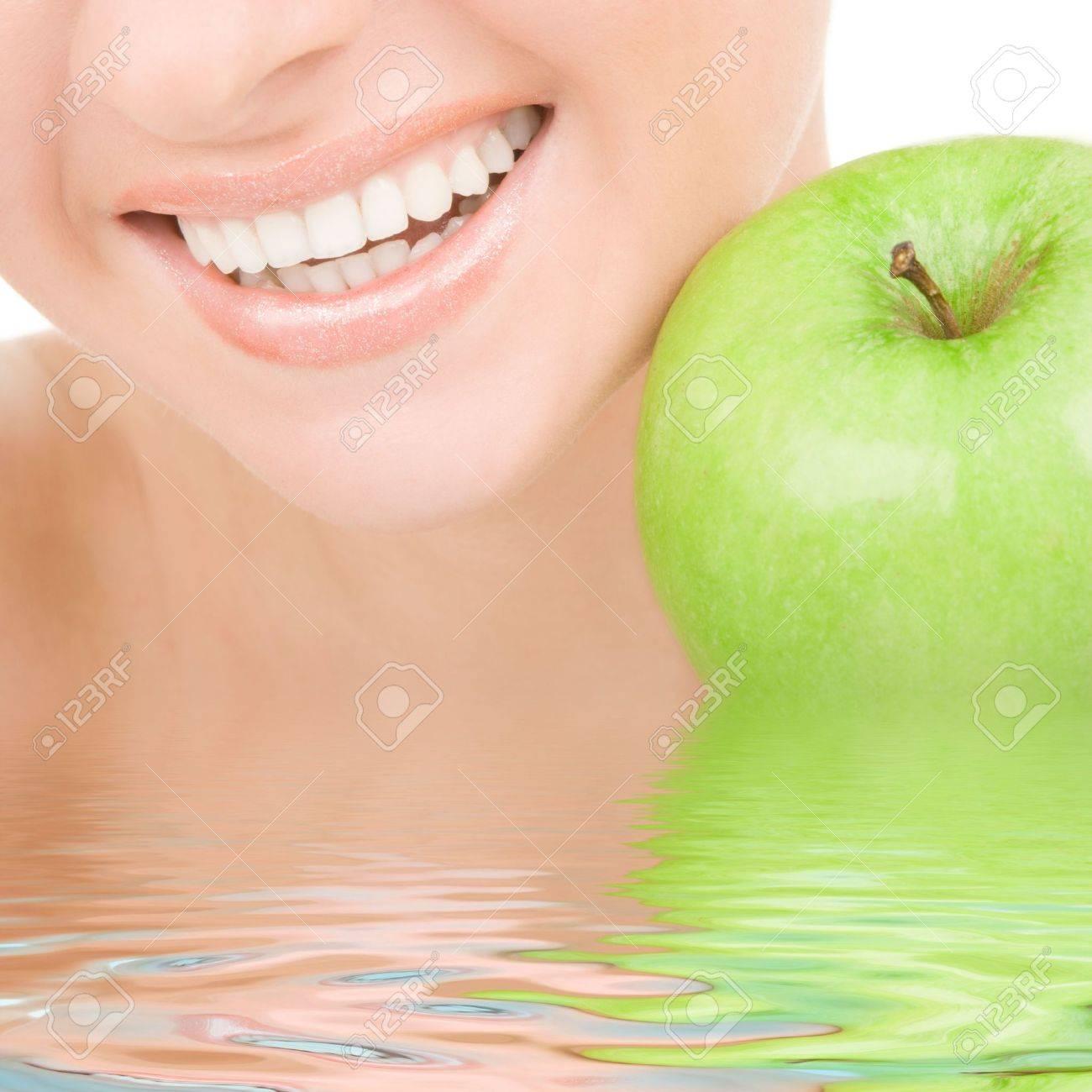 healthy teeth and green apple Stock Photo - 5334965