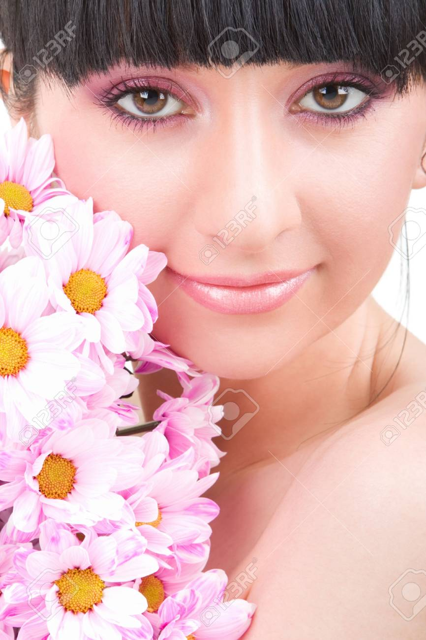 Young woman with pink flowers Stock Photo - 5613493