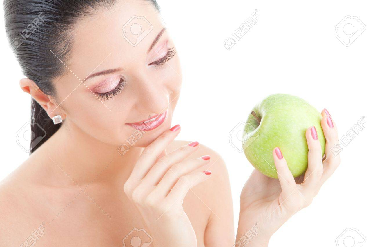 pretty woman with green apple isolated over white background Stock Photo - 5620626