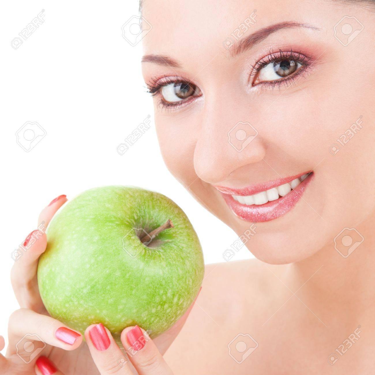 sweet girl eating green apple on white background Stock Photo - 7521007