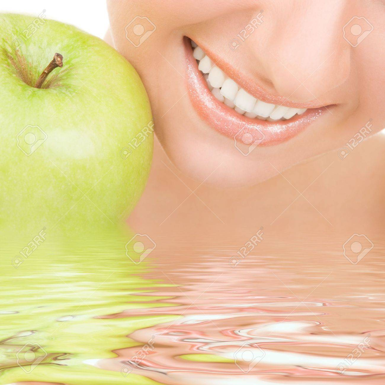 healthy teeth and green apple Stock Photo - 9112011