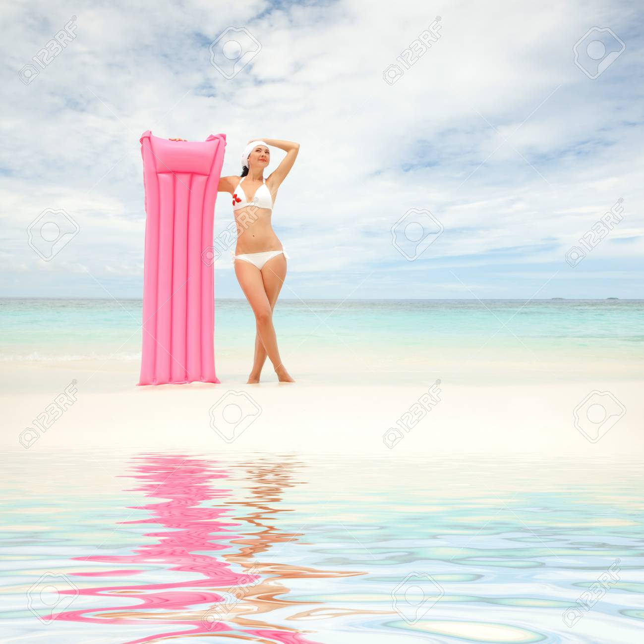 Happy woman with inflatable mattress on the beach Stock Photo - 12941327