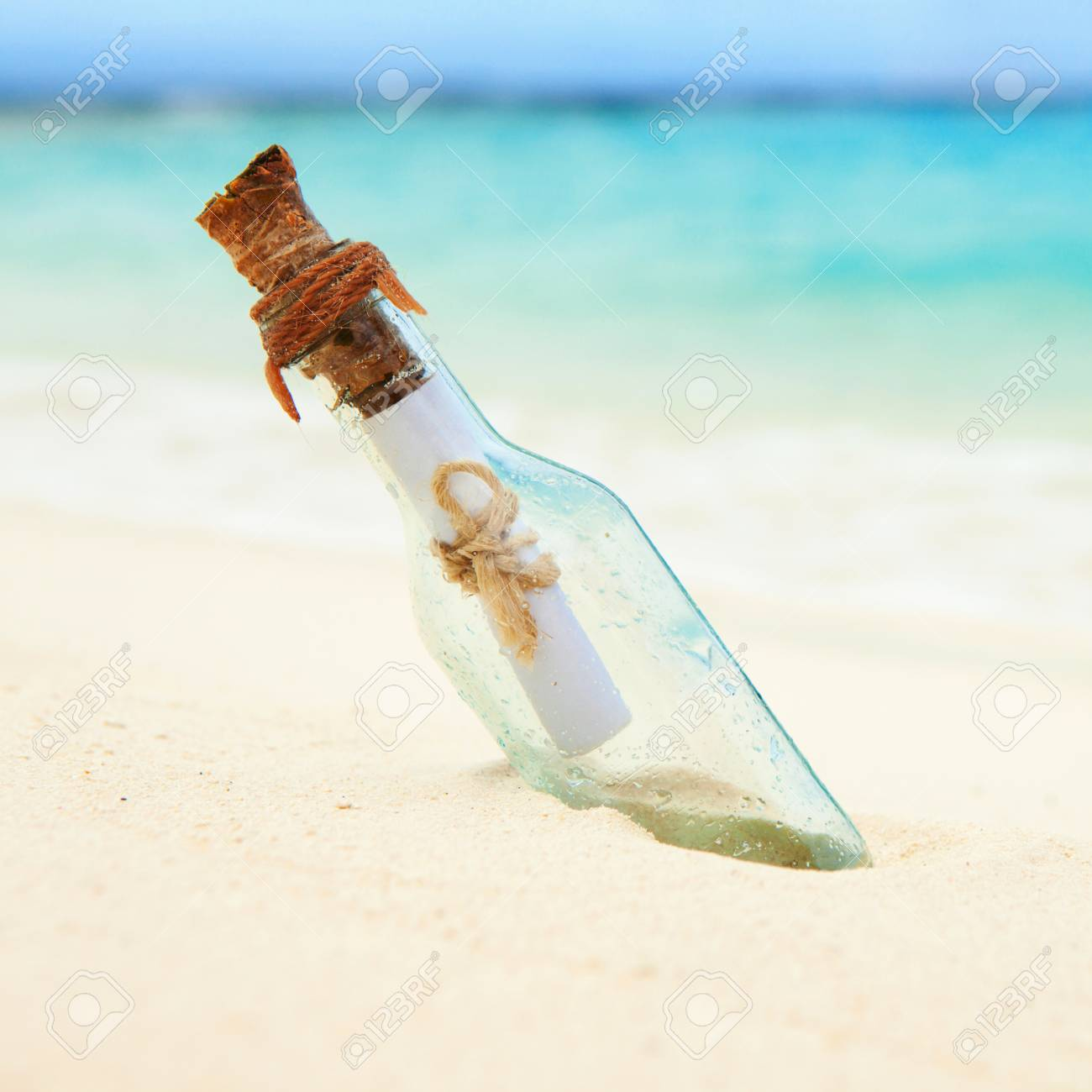 a letter in a bottle on the beach stock photo 22707248