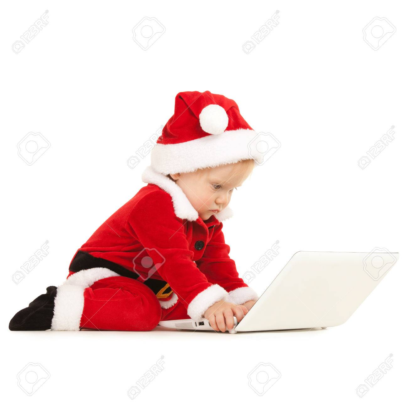 1cccc2c89 Cute santa baby with laptop on the white background Stock Photo - 24679437