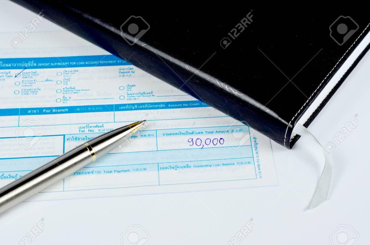 classic pen on deposit slip Stock Photo - 22272098