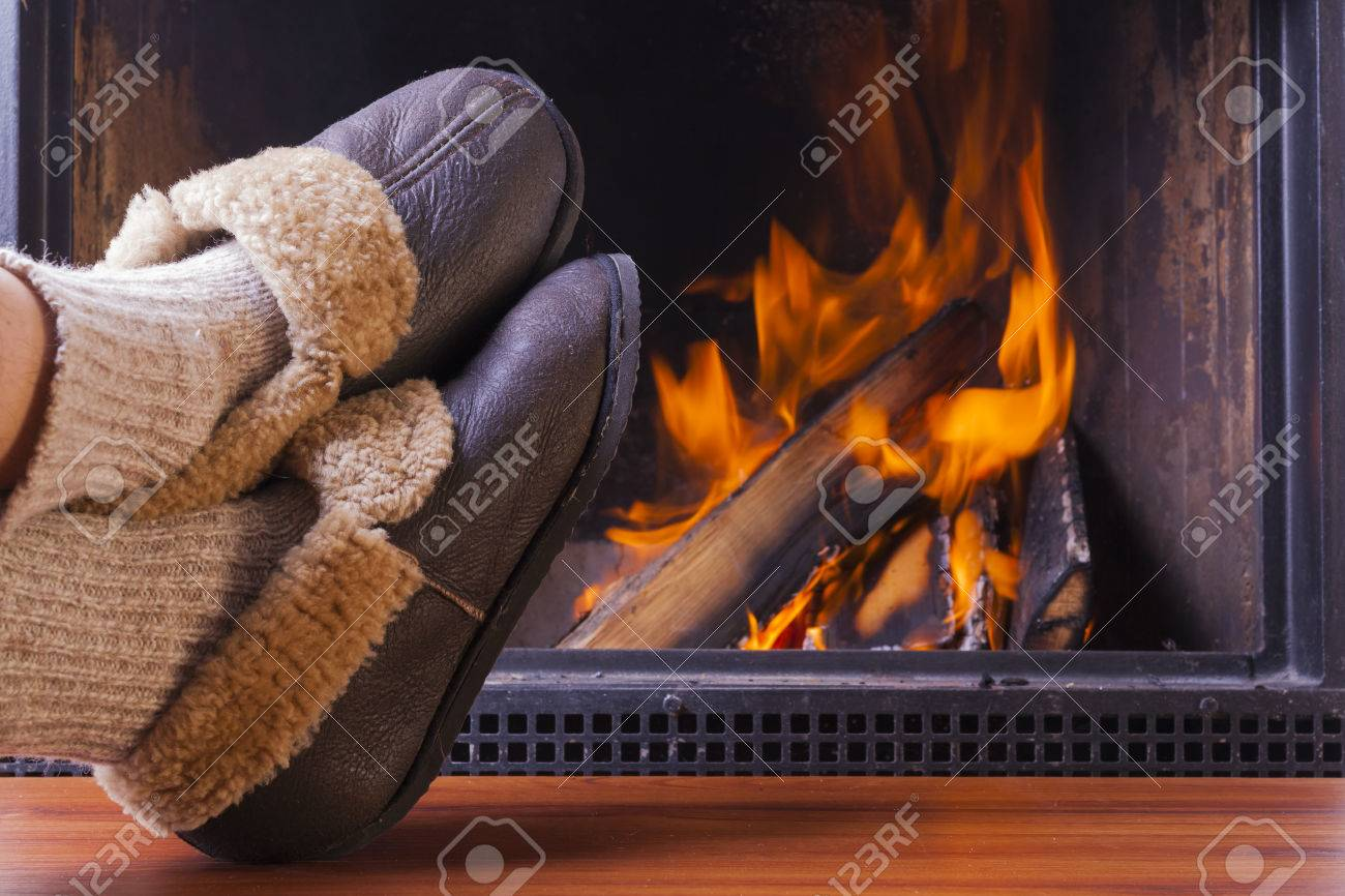 Relaxing In Comfy Rustic Slippers At Cozy Warm Fireplace In Winter