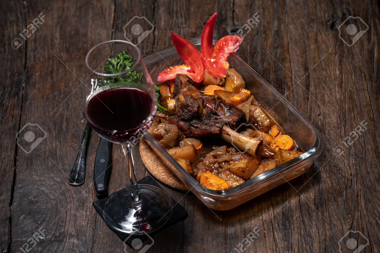 Roasted lamb leg with potatoes fresh oven cooked. Delicious roasted ribs - 155723967