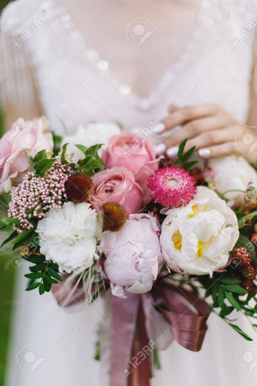 Wedding Bouquet With White And Pink Rose Peonies And Greenery Stock Photo Picture And Royalty Free Image Image 99206898