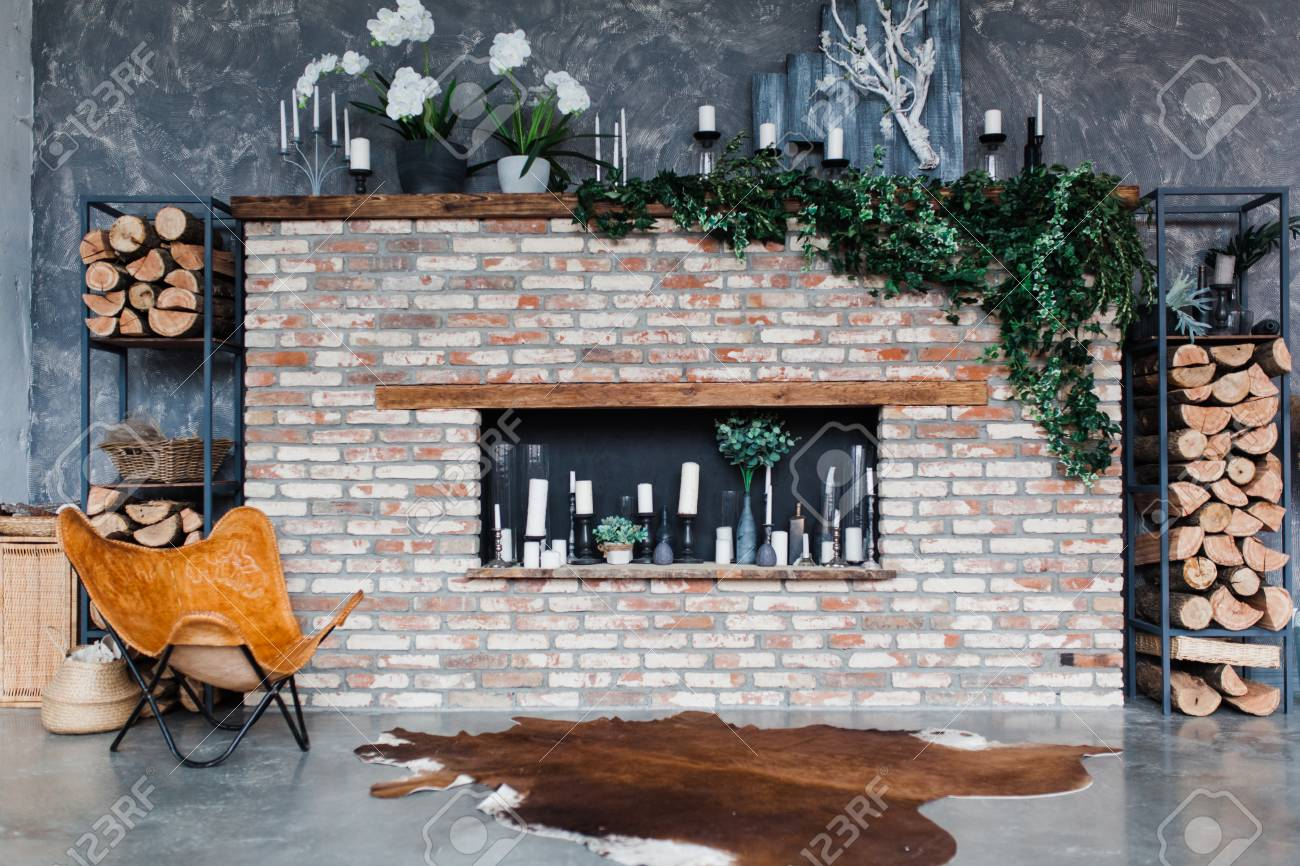 Loft Style Interior With Brick Fireplace Candles Greenery