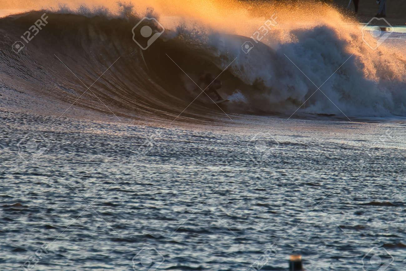 Surfing big waves in Santa Barbara Harbor - 165492623