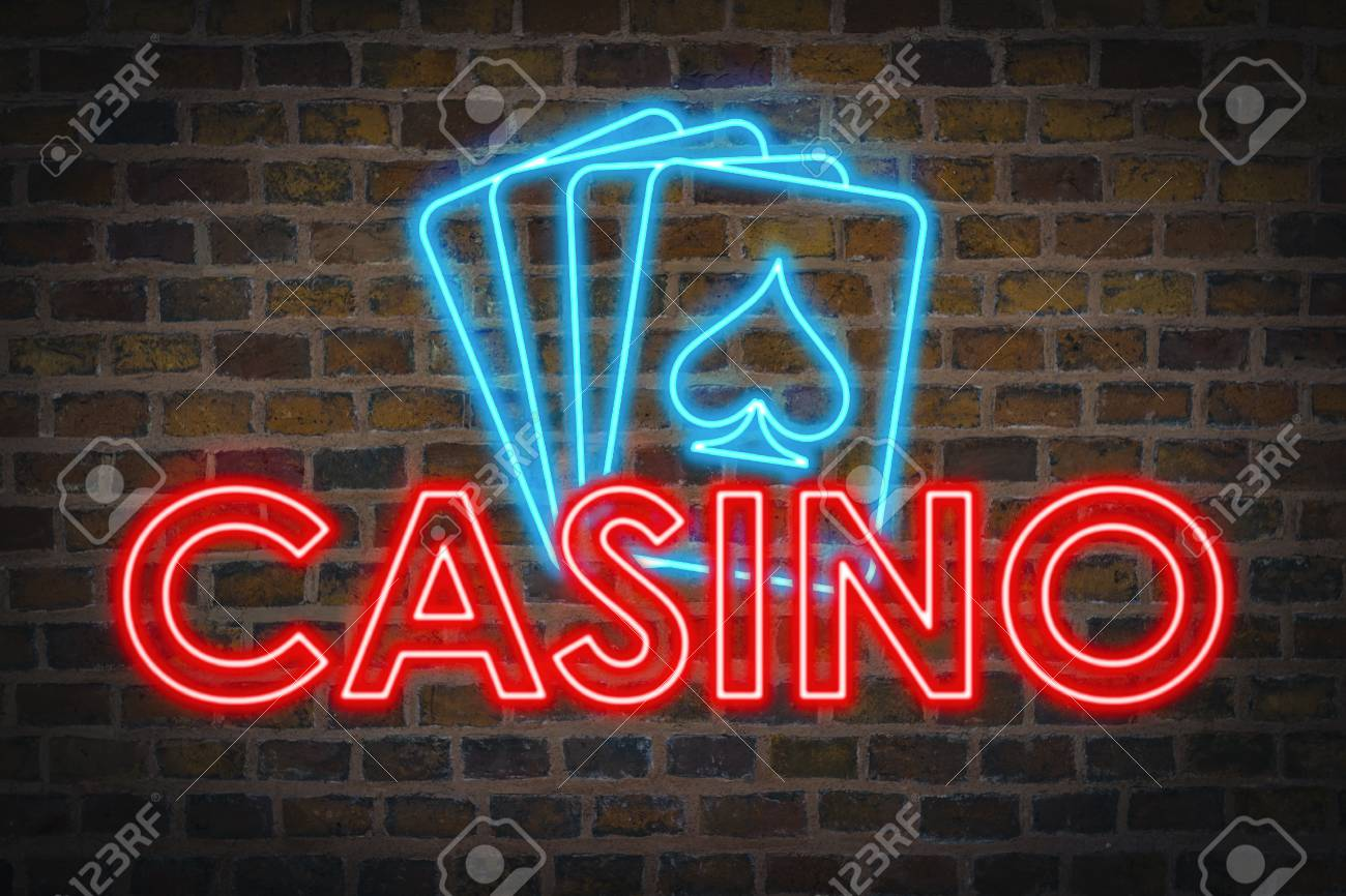 Light Neon sign with text Casino and Four playing cards on the background of a ceramic wall. - 115154272