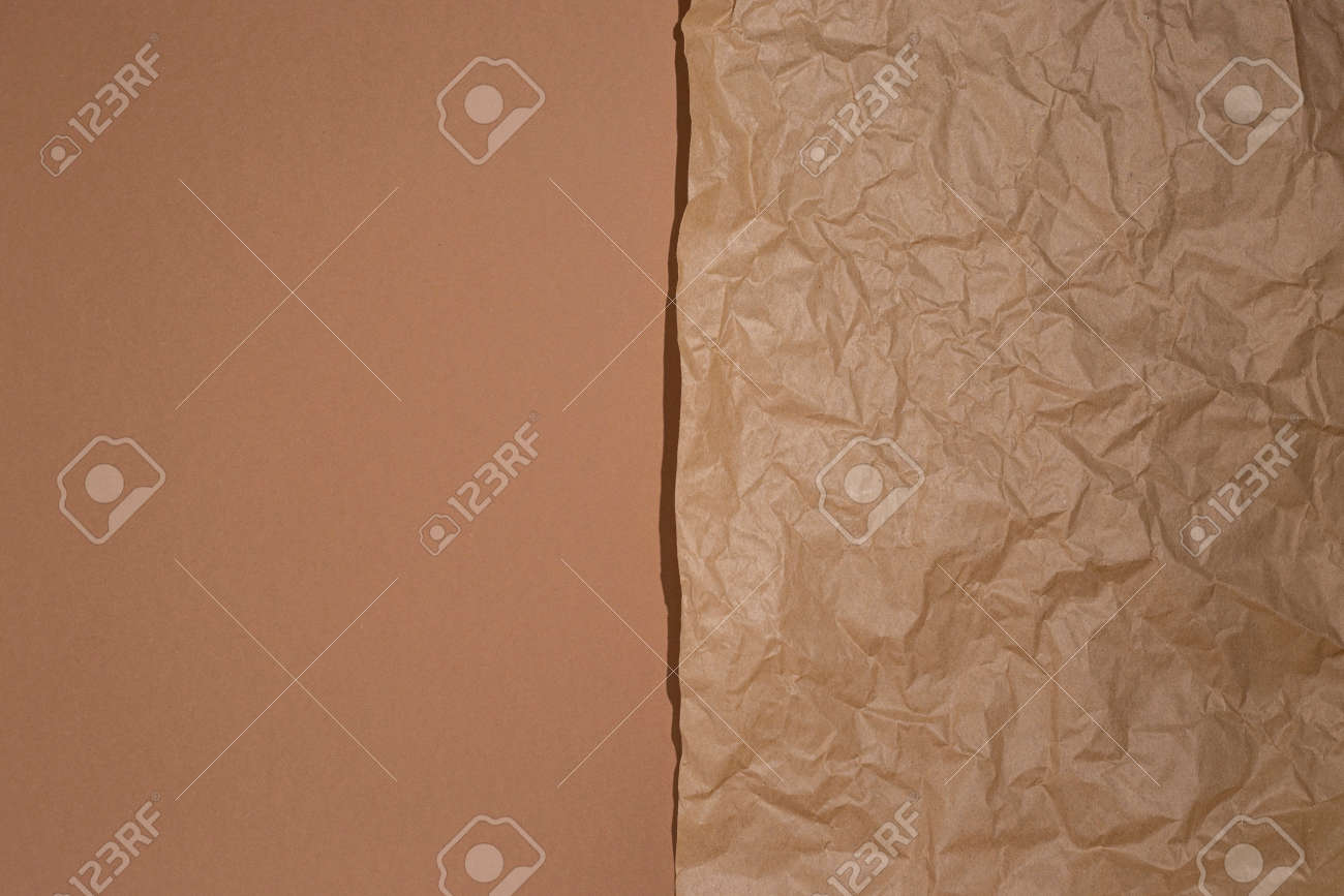 Crumpled craft paper on a brown cardboard background. - 171756560
