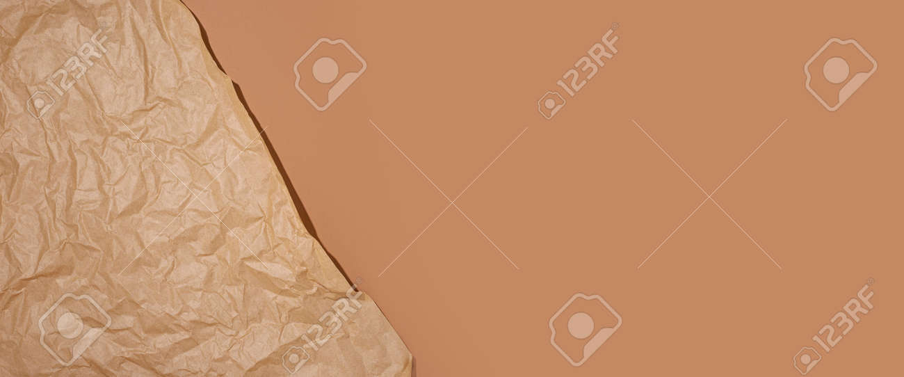 Crumpled craft paper on a brown cardboard background. Banner. - 171756567
