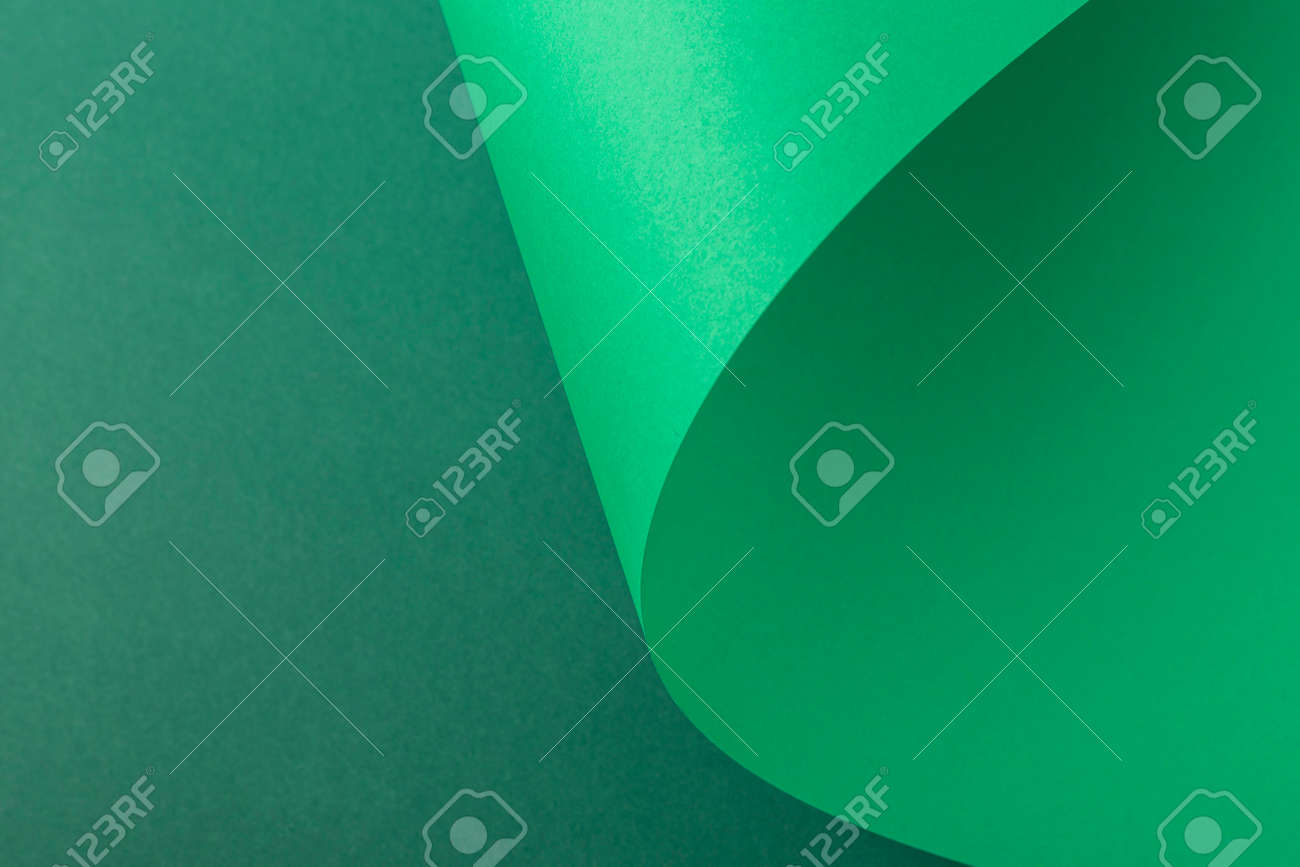 Design background of folded curl from green cardboard. Top view, flat lay. - 171847653