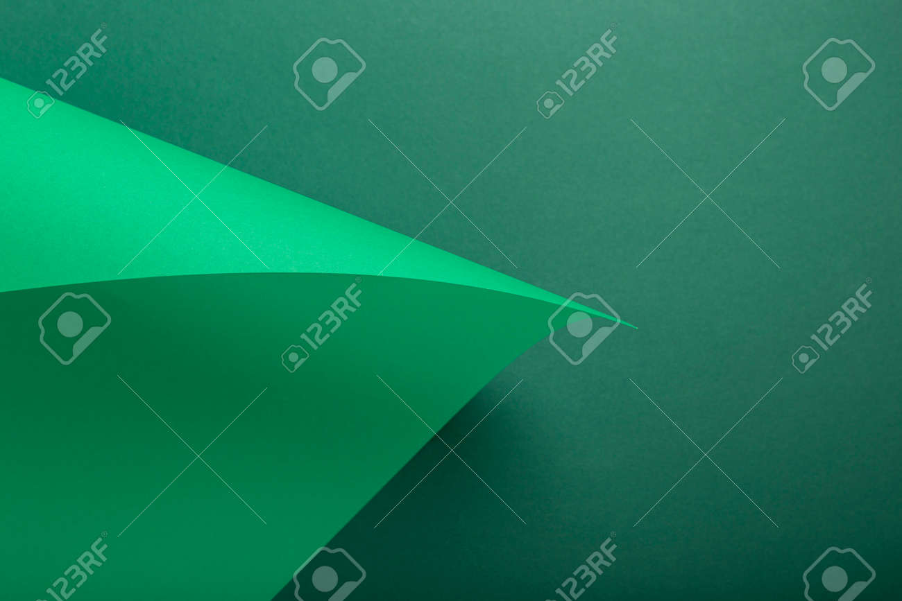 Design background curved background from green cardboard. Top view, flat lay. - 171847657