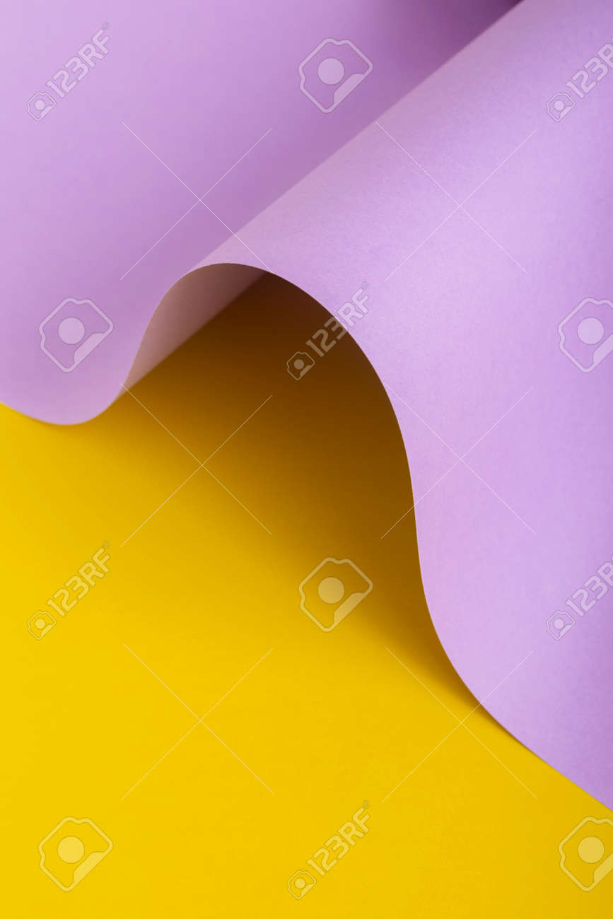 Wave from lilac cardboard on a yellow background. Top view, flat lay. - 171847661