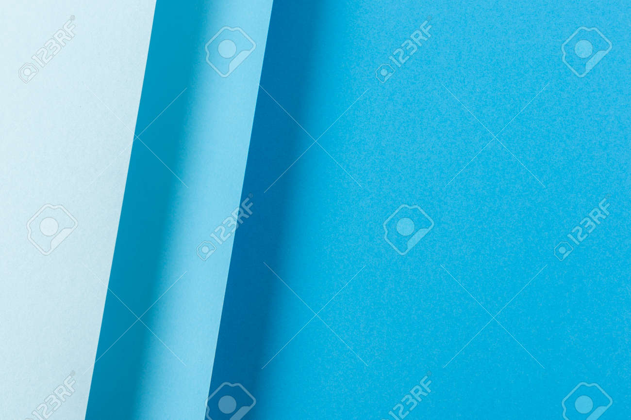 Colorful blue folded paper material design. Top view, flat lay. - 171847664
