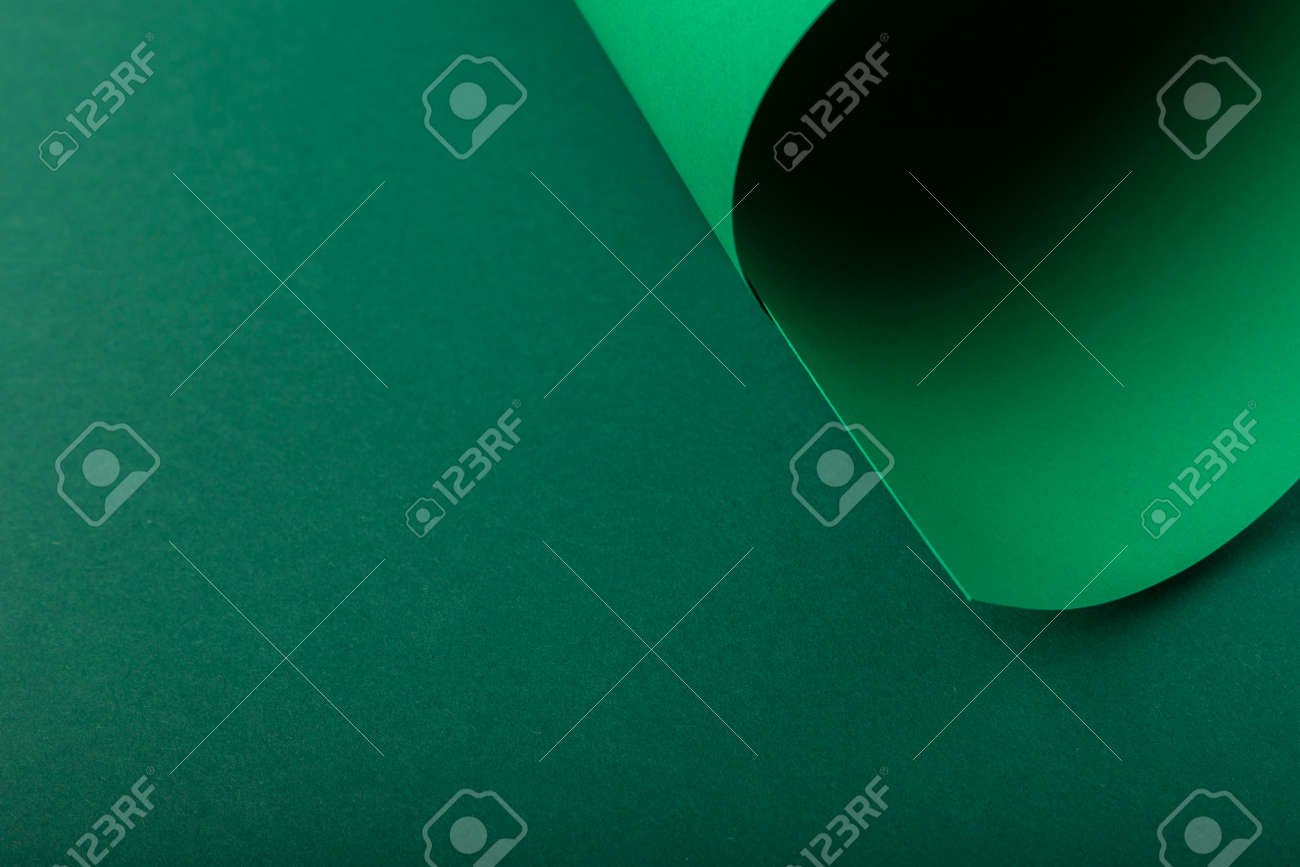Design background of folded curl from green cardboard. Top view, flat lay. - 171847669