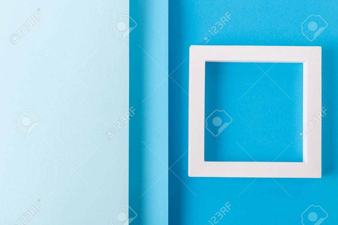 Square podiums on a background of blue cardboard design of folded paper material. Top view, flat lay. - 171847681