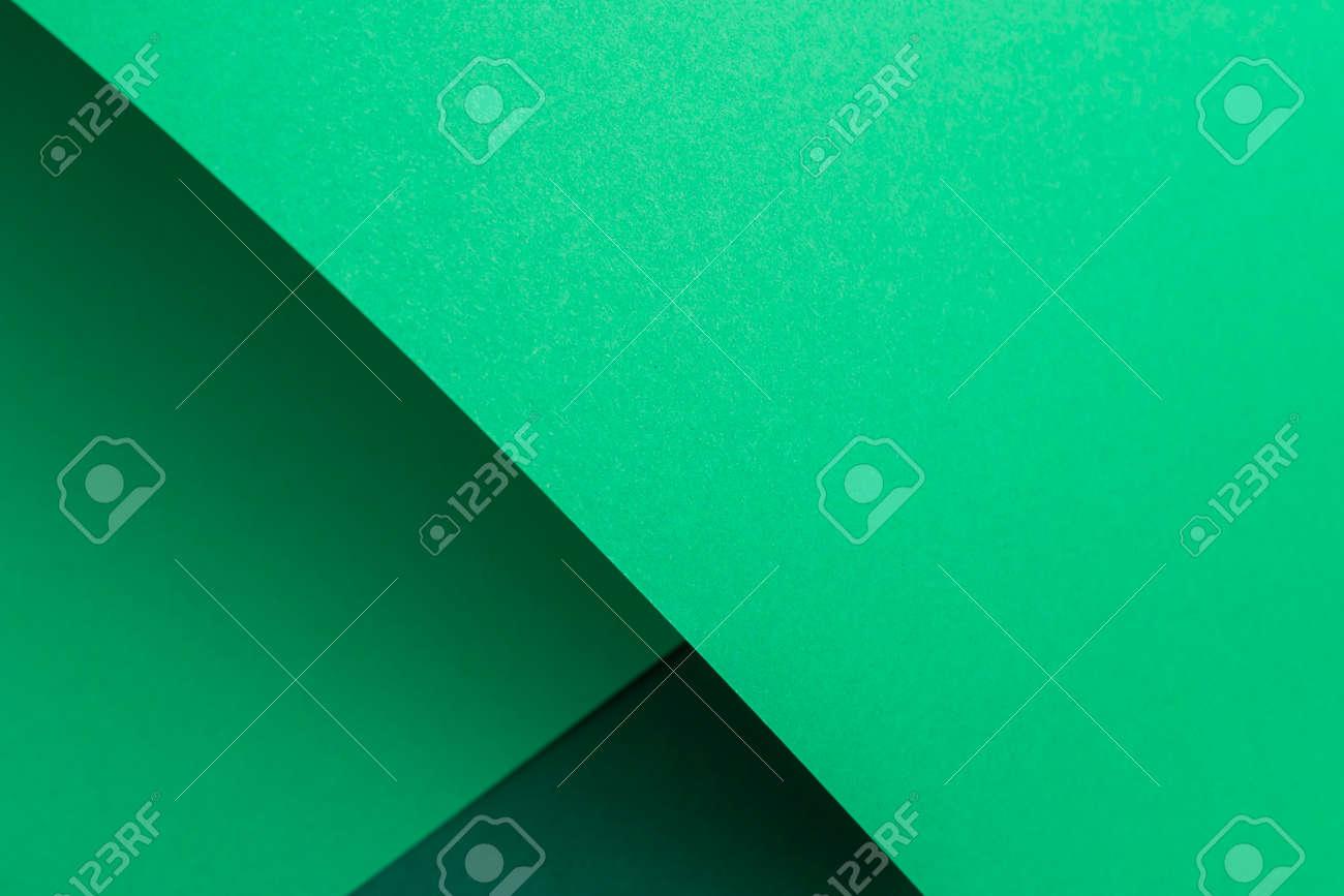 Green cardboard background design folded geometrically. Top view, flat lay. - 171847683