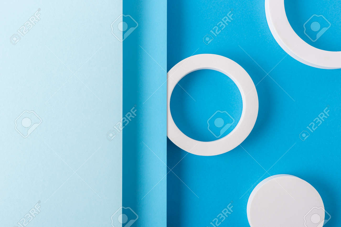 Round podiums on light blue background design of folded paper material. Top view, flat lay. - 171847689