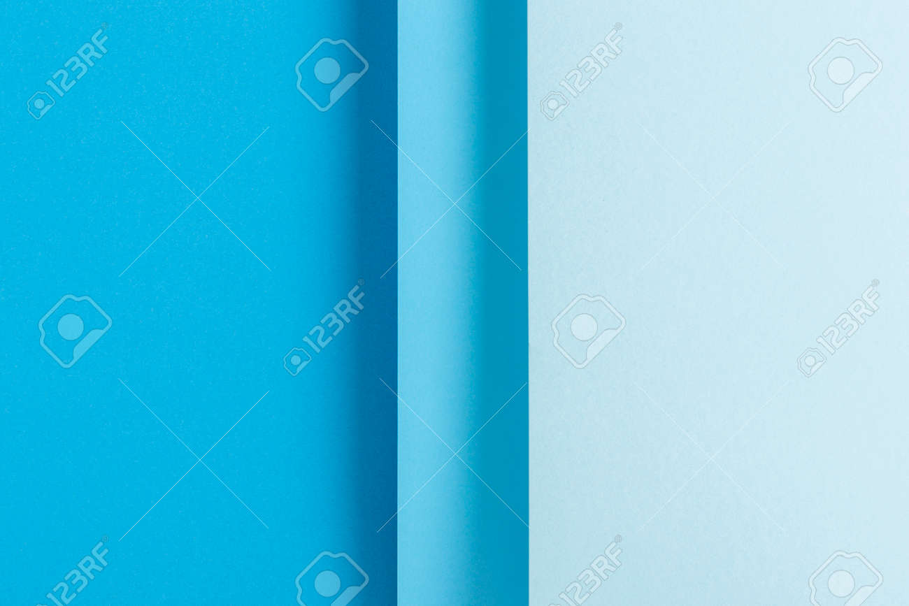 Colorful blue folded paper material design. Top view, flat lay. - 171847720
