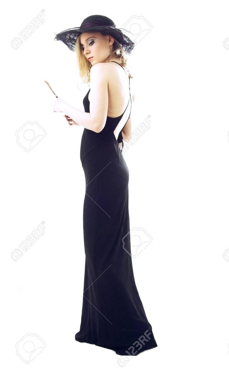 on sale dd068 33af9 Retrò ragazza in abito da sera e un cappello su uno sfondo bianco