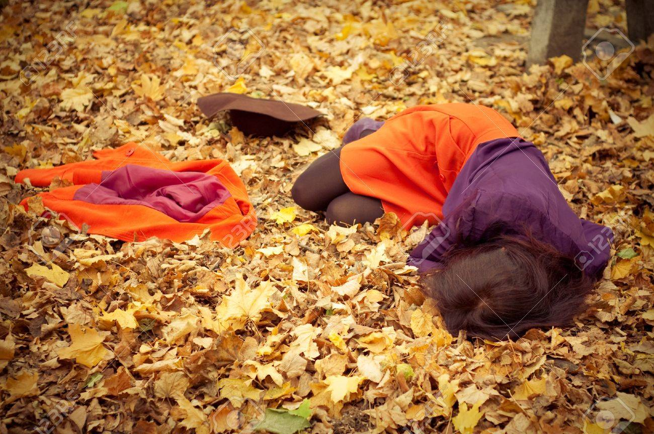 girl lies among the fallen yellow leaves Stock Photo - 10973260