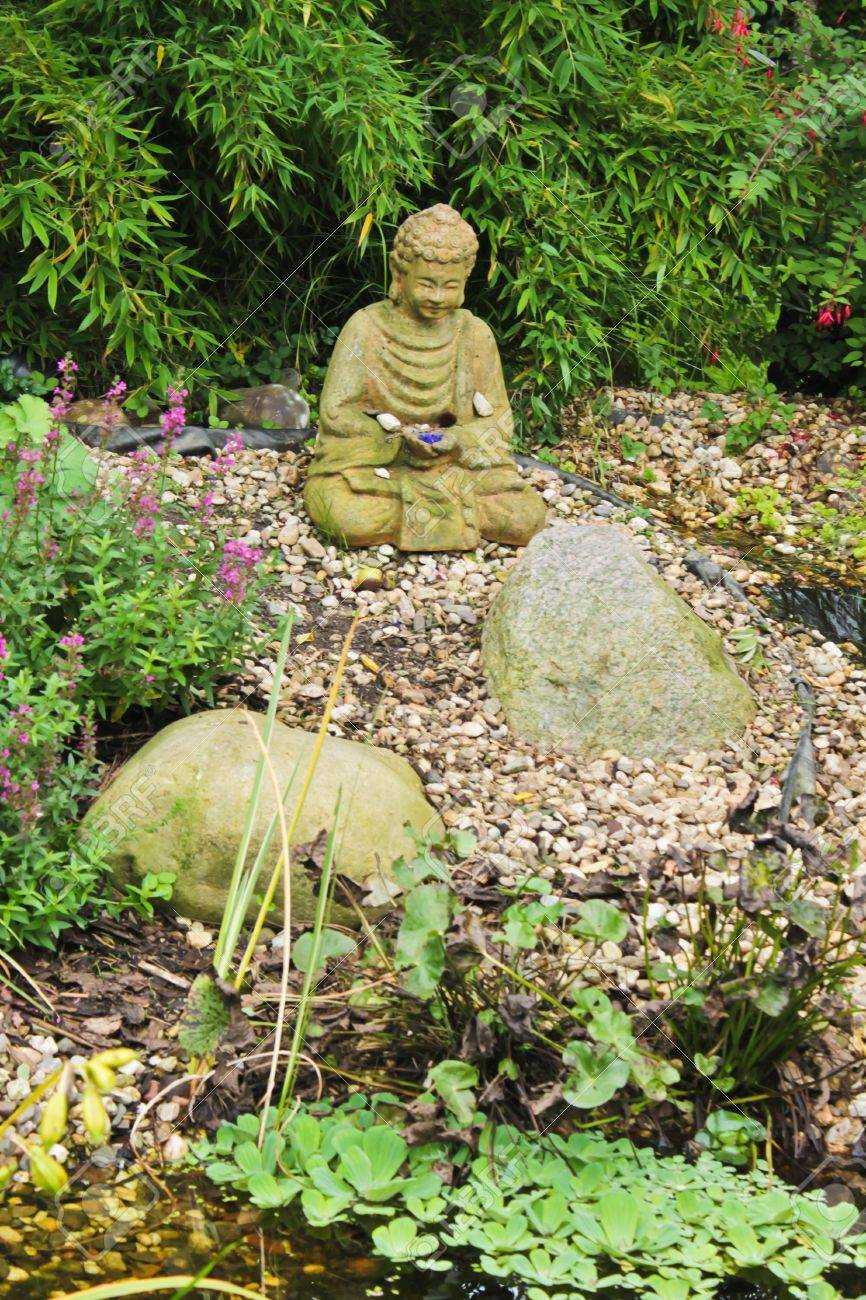Delightful Photo With Zen Garden With Green Plants And Buddha Sculpture Stock Photo    11380122