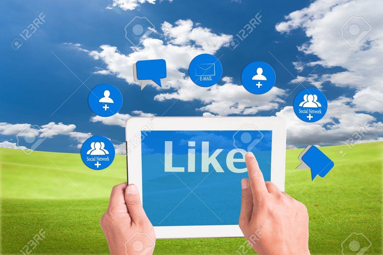hand holding a touchpad pc and press like button with mail , add friend and comment icons Stock Photo - 9733641