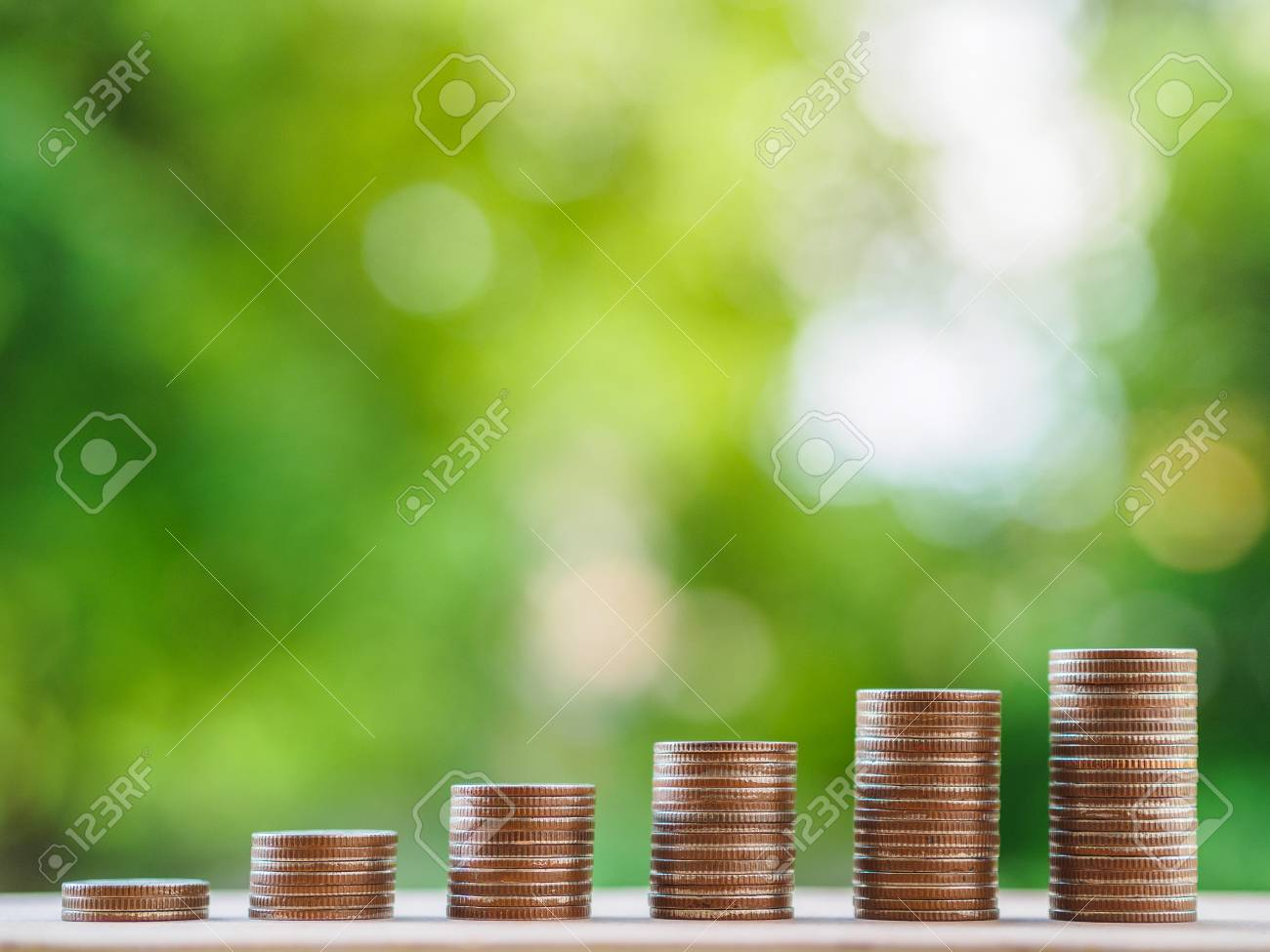 Saving money concept. growing business concept. money coin stack on the table on bokeh background. - 106388103