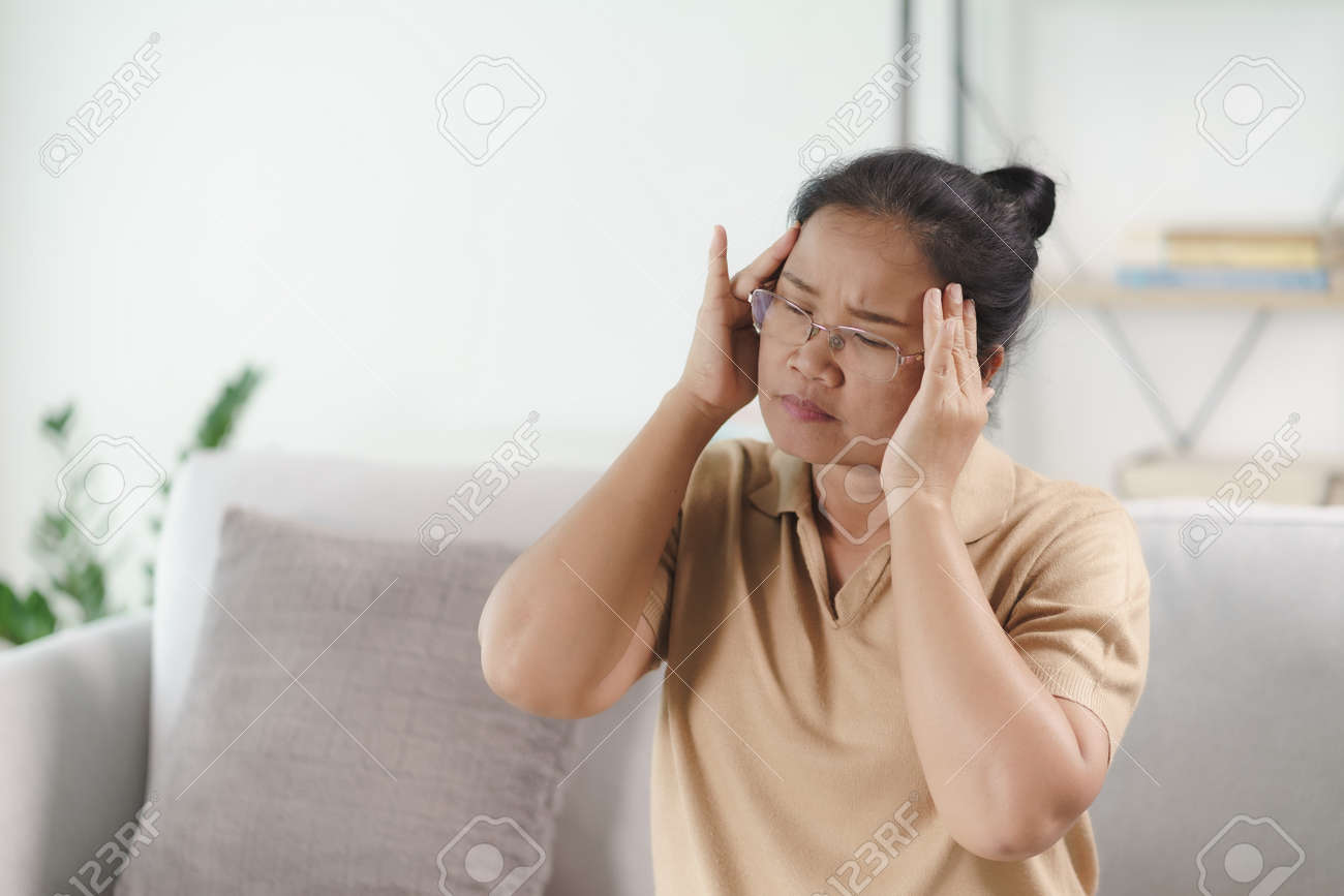 Exhausted tired depressed stressed thoughtful mature senior woman suffering from headaches, Brain diseases, mental problems, Alzheimer Concept. - 171855591