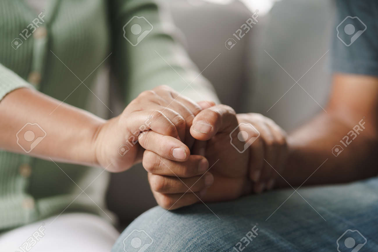 Female friend or family sitting and hold hands during cheer up to mental depress man, Psychologist provides mental aid to patient. PTSD Mental health concept - 171880958