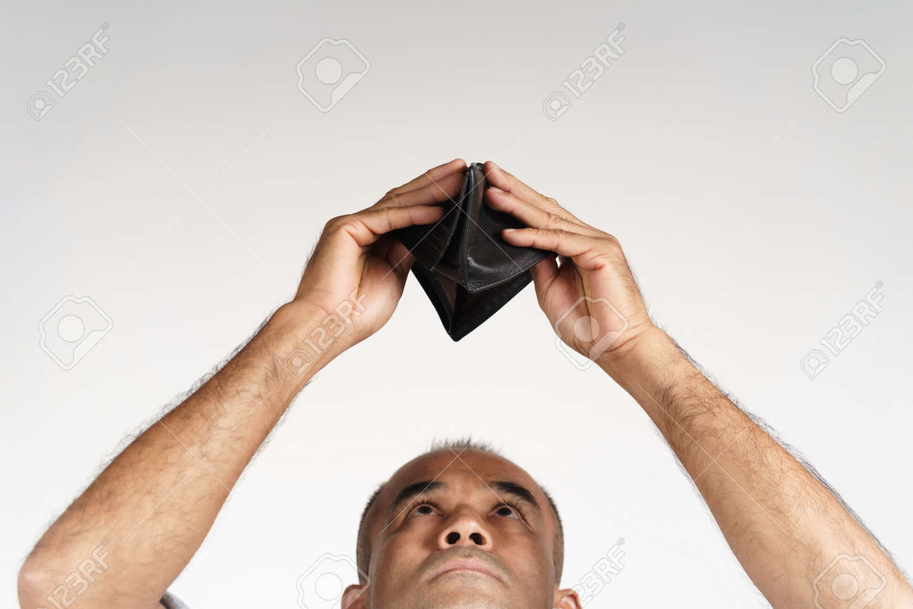 Upset mature man holding upside down and looking inside his empty wallet on white background. financial crisis, bankruptcy, no money, bad economy Concept. - 171949172