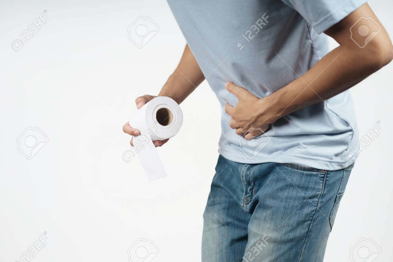 Young man holding his stomach and tissue paper suffering from Diarrhea, incontinence, prostatitis, venereal disease. Healthcare concept. - 171935890