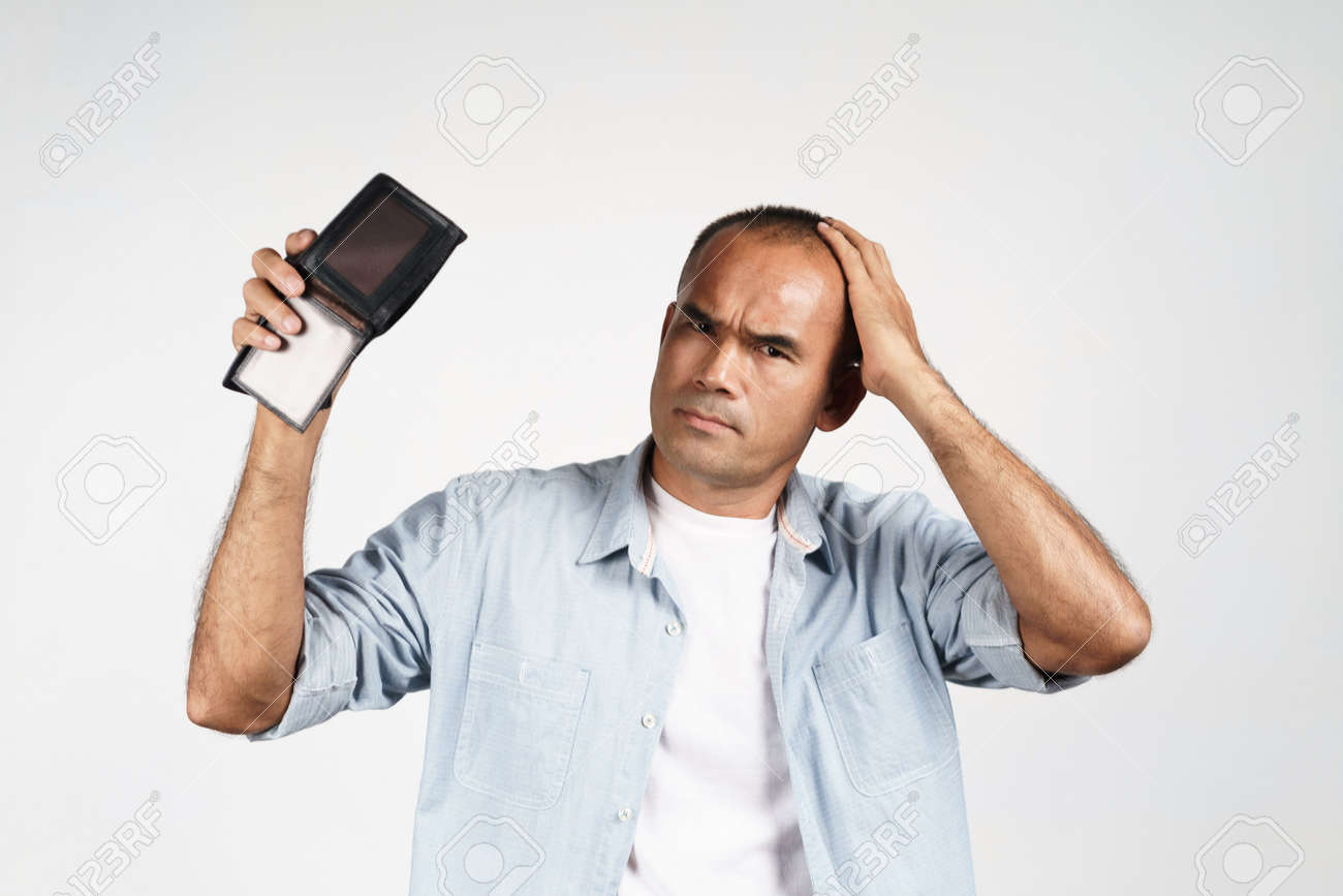 Upset mature man holding his empty wallet on white background. financial crisis, bankruptcy, no money, bad economy Concept. - 171949174