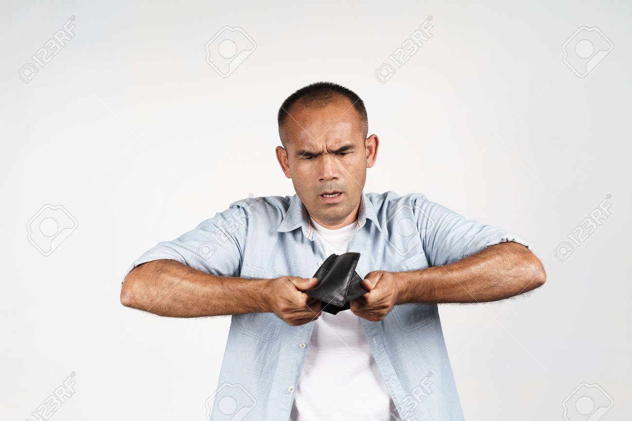 Upset mature man holding upside down and looking inside his empty wallet on white background. financial crisis, bankruptcy, no money, bad economy Concept. - 171949187
