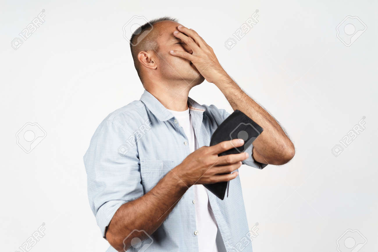 Upset mature man holding his empty wallet on white background. financial crisis, bankruptcy, no money, bad economy Concept. - 171935808