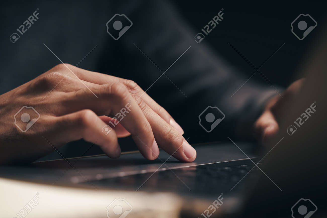 Closeup of a man using a laptop computer on the wooden table, searching, browsing, social media, message, email, internet digital marketing, online shopping. - 172185692