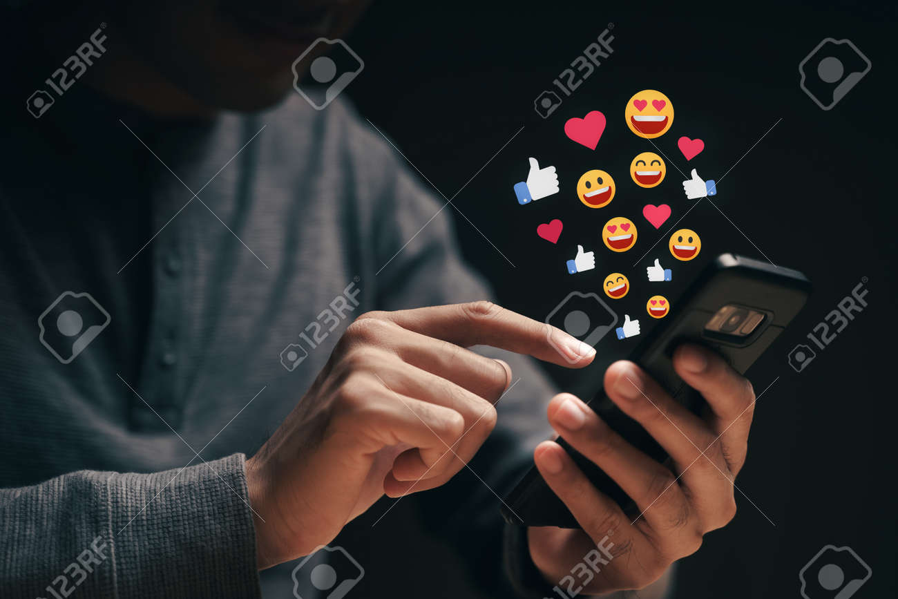 Happy young man using smartphone chatting on Social network sending Emoji, Emoticon. Social media, Live Streaming Concept. - 172263054