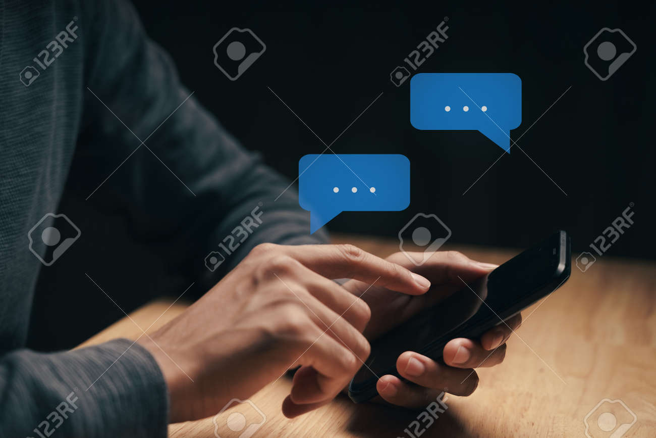 Young man using smartphone typing, chatting conversation with pop up chat box icons. Social Network, technology concept - 172263058