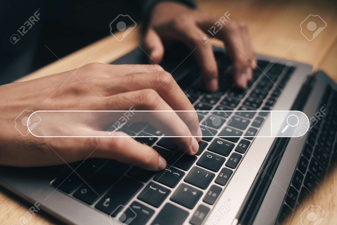 Man using a laptop computer to Searching for information with the Search bar, Web browser, Data Search, Search Engine, Technology Concept - 172263061