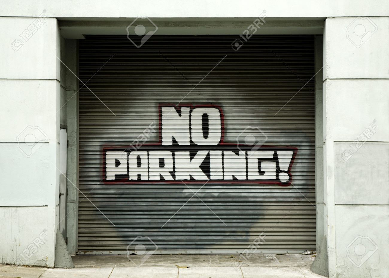 No Parking Sign On Garage Door In Urban Area Stock Photo Picture