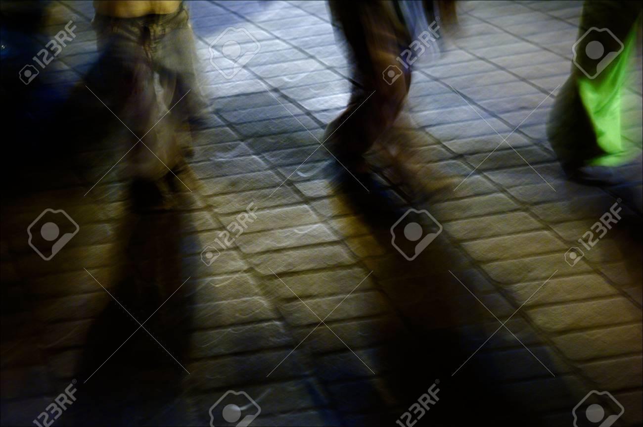 Feet march on a stone blocks in city twilight. Stock Photo - 7745807