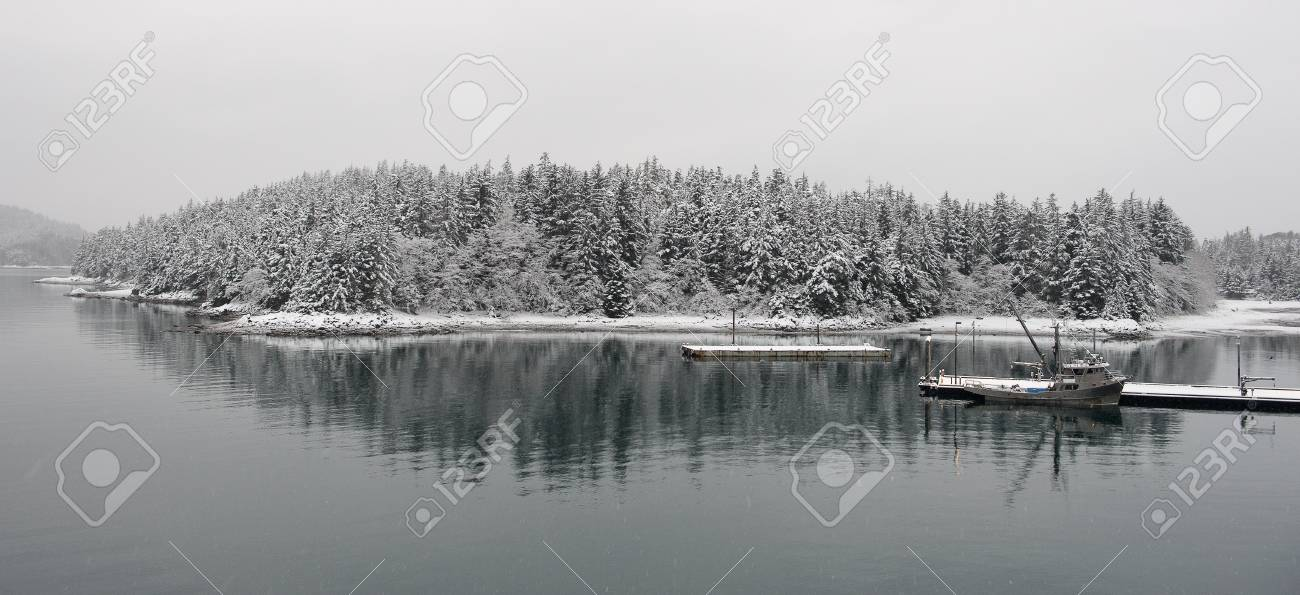 Fishing vessel at the snow-covered mooring. Stock Photo - 25234701