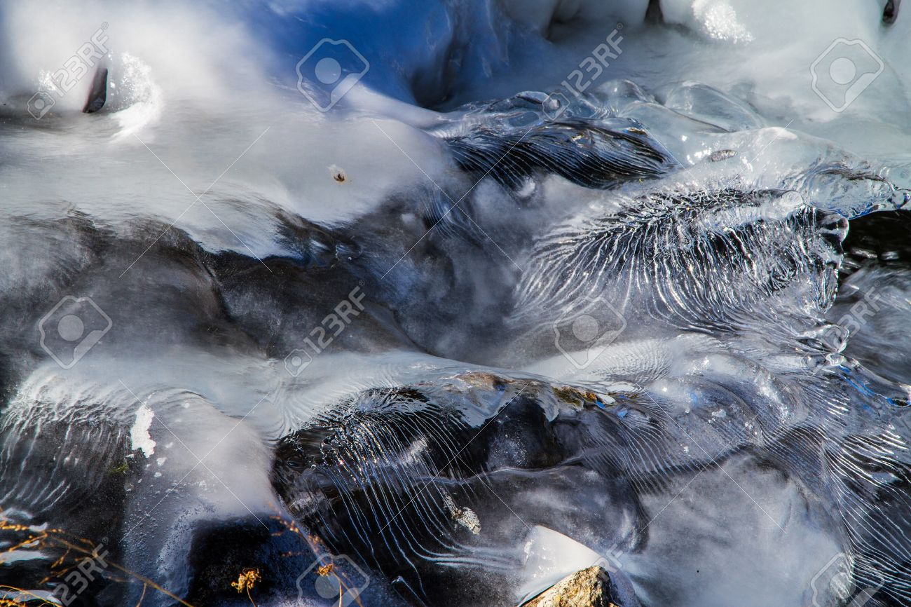 Ice waves frozen as frigid water cascaded down a waterfal creating unique ice sculptures Stock Photo - 16540946