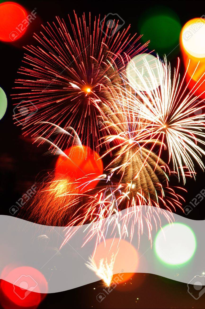 Multicolored Bokeh lights and fireworks populate a night scene in a vertical background with a transparent space at bottom for copy. Stock Photo - 16791179